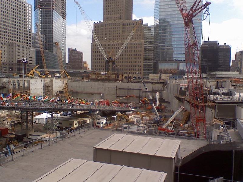 A fully operating Path train station is to the right in this photo, behind the cement walls beyond the crane. Photo taken of Ground Zero on September 11, 2008